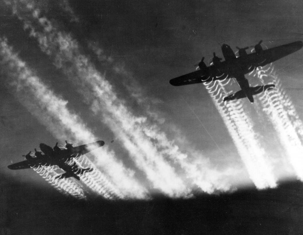 EASTERN EUROPE -- The vapor trails from two Boeing B-17 Flying Fortress  aircraft light up the night sky. The B-17 is one of the most famous airplanes ever built. The B-17 prototype first flew on July 28, 1935. Few B-17s were in service on December 7, 1941, but production quickly accelerated. The aircraft served in every WW II combat zone, but is best known for daylight strategic bombing of German industrial targets. (U.S. Air Force file photo)