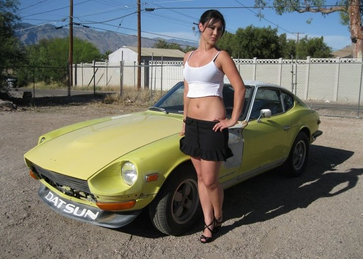 pretty girl in front of a datsun 240z