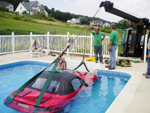 miata getting pulled from a pool
