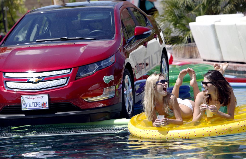 chevy volt in pool with bikini girls