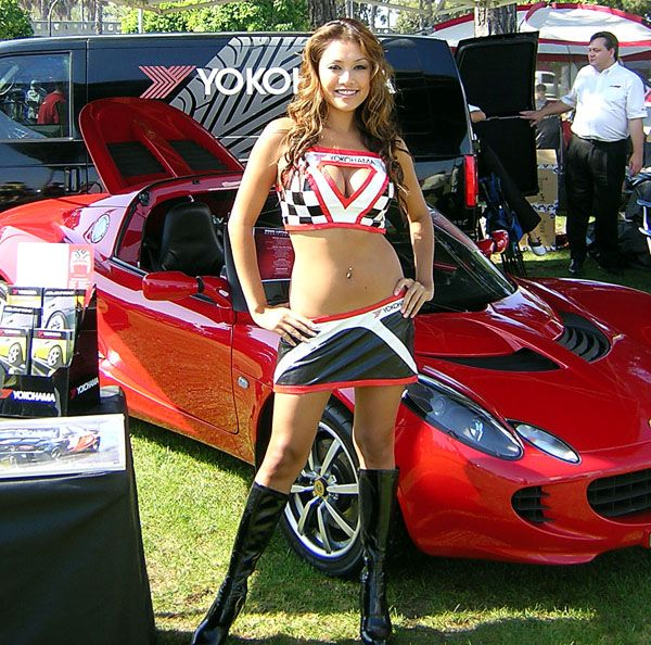 Hot Japanese Girl in front of Lotus, showing her colors