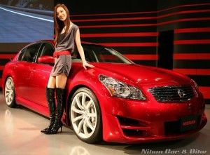 Pretty girl next to her Infiniti G35x AWD