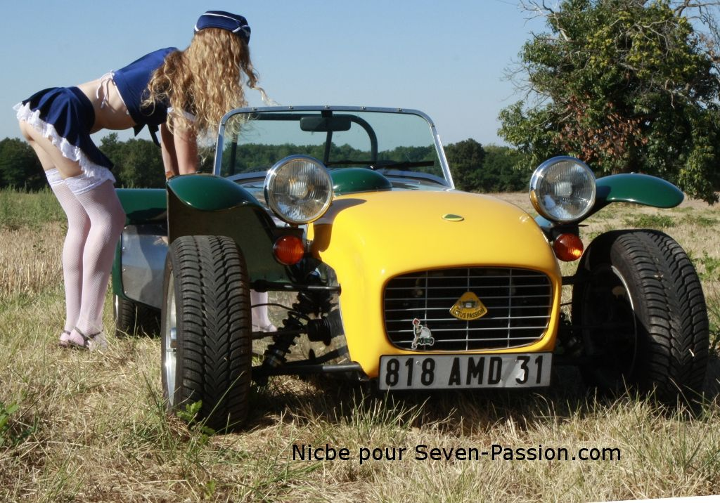 pretty girl in white leggings next to lotus seven