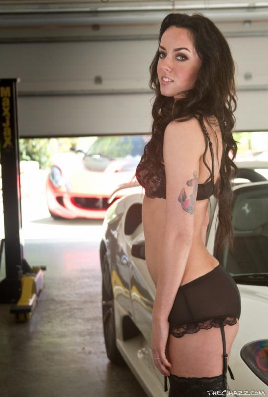 very pretty hot ferrari girl with lotus elise in background