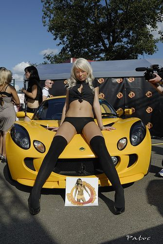 girl in very small black outfit with lotus elise
