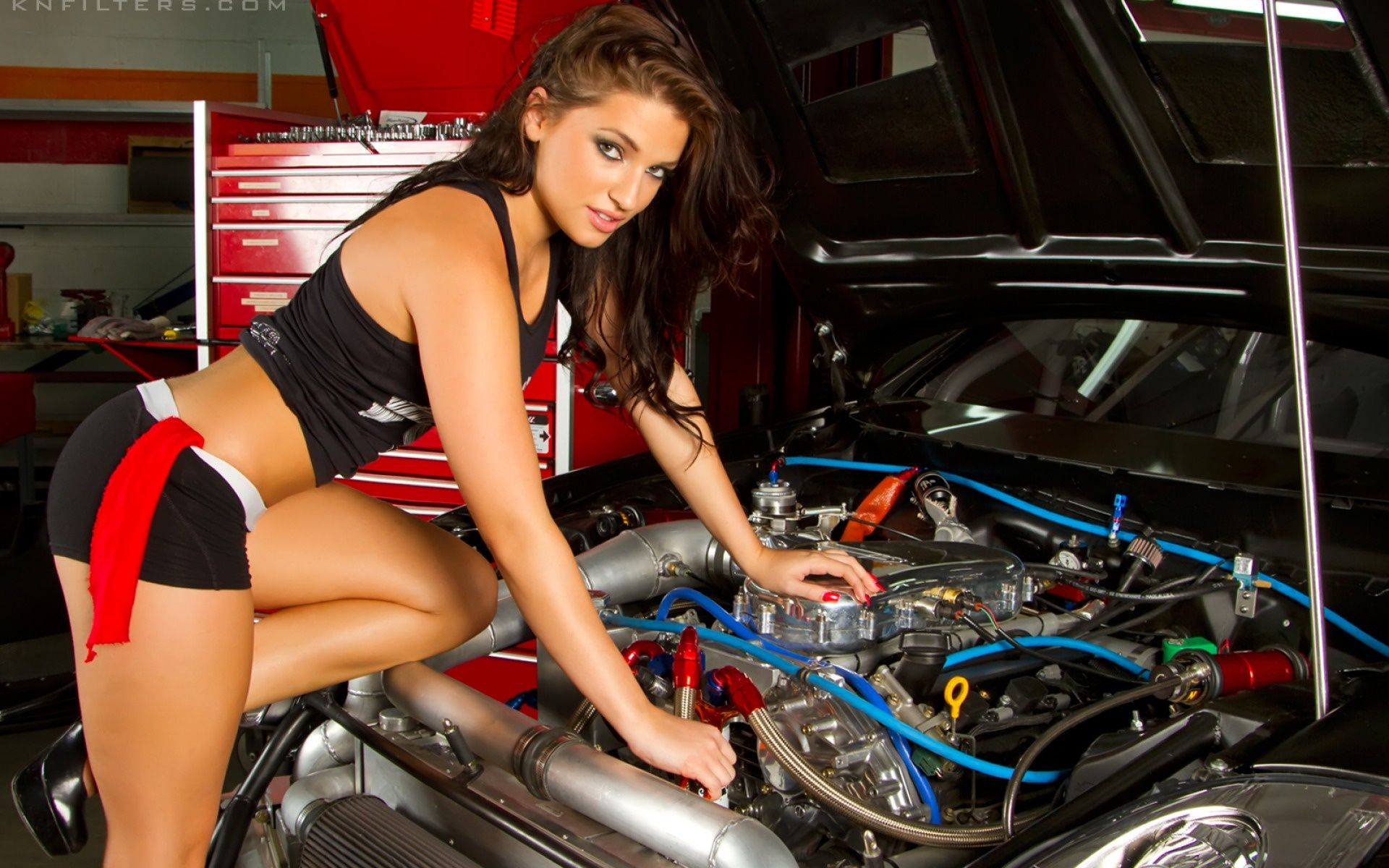 mechanic girl fixing a car